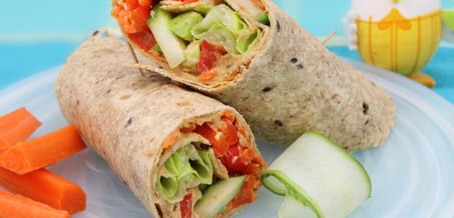 Vegetarian Roasted Red Pepper and Avocado Wrap with Spicy Hummus